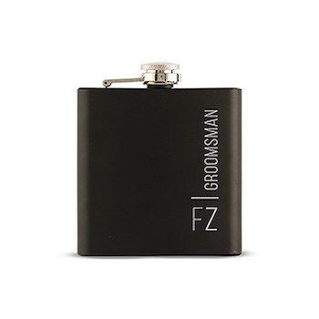 Black Vertically Personalised Hip Flask Gift For Men. Laser etch initials, wedding party roles or surname and you find a truly unique Black Vertically Personalised Hip Flask Gift For Men that will be sure to thrill anyone who receives it. Great for groomsmen, dads and boyfriends, this customised black 6 oz hip flask is a must for the stylish gift giver. 9.5cm (L) x 2cm (W) x 10.5cm (H) Coated Stainless Steel Holds 6 oz. (177ml)