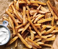 Gwenyth Paltrow's No-Fry Fries: 2 lrg russet potatoes; 2 tbsp olive oil; coarse sea salt. Heat oven to 450°. Cut potatoes in half horizontally; cut each half into 1/3-inch-thick fries and place in a bowl of cold water. Remove from water and dry thoroughly. Toss with oil and sprinkle with salt. Place fries on a cookie sheet. Roast until browned and cooked through, turning occasionally, 25 minutes.