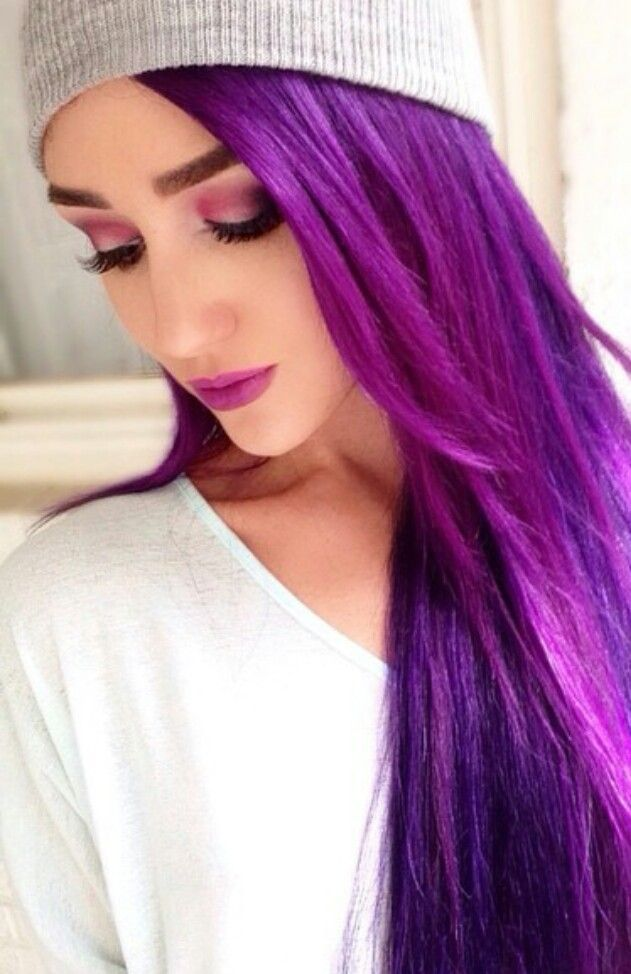 Love the eye makeup with her Purple hair!
