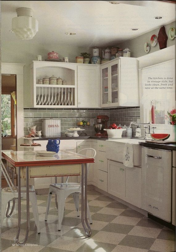 love the subtle color of backsplash and checkerboard floor--warms up an otherwise all-white kitchen without committing to stronger accent color