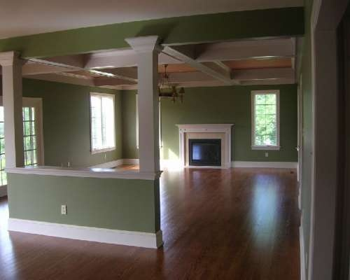 Family room with ceiling beams and columns located in for Family room columns