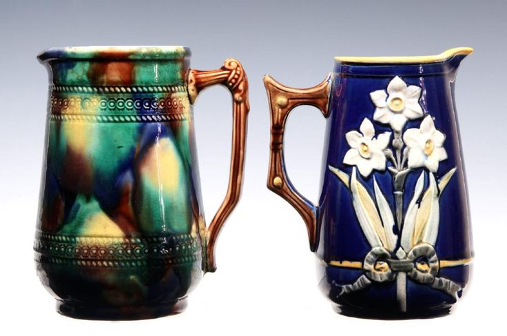 Lot: TWO 19TH CENTURY MAJOLICA POTTERY PITCHERS, Lot Number: 0064, Starting Bid: $60, Auctioneer: Soulis Auctions, Auction: An Eclectic Little Auction, Date: April 30th, 2017 MDT