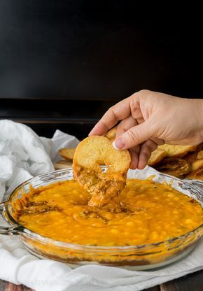 Cheesy Chili Taco Dip with Homemade Bagel Chips: Green chilies, cream cheese, cheddar cheese and no-bean chili, this taco dip recipe from I Wash, You Dry features homemade Thomas' Mini Bagels chips for one delicious snack.