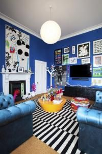 The owners love to collect graphic prints to fill the wall spaces and have created a piece of art by stretching Marimekko fabric over a canv...