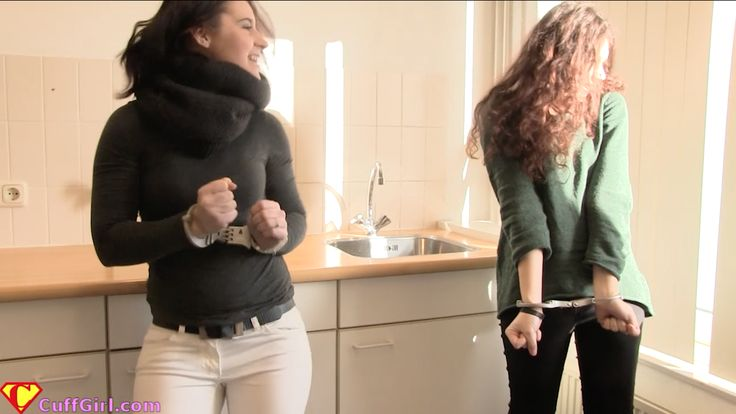 Two Friends Have Fun Wearing Handcuffs In Kitchen