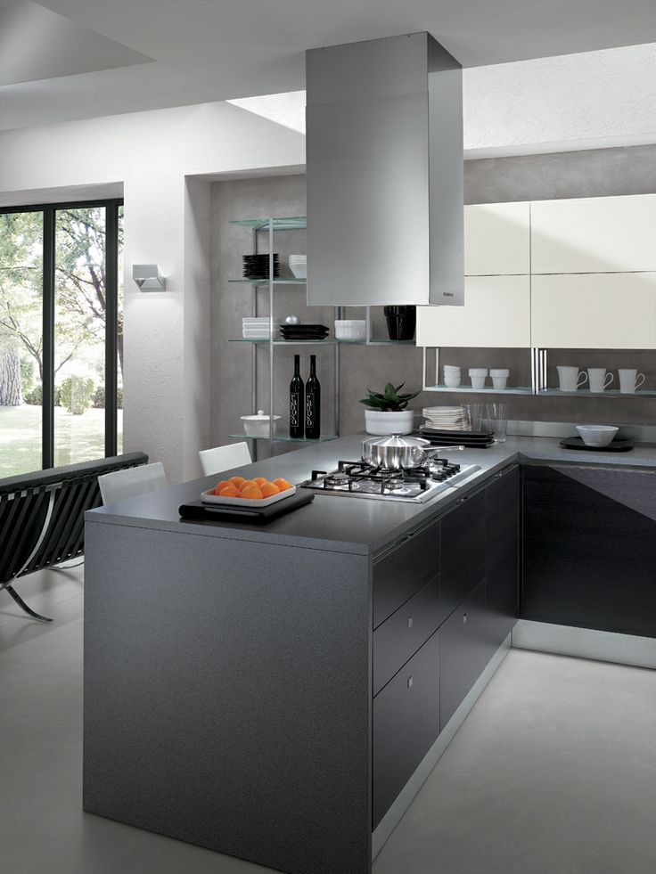 An elegant composition with handles integral in the door and effective use of contrasting colours | The kitchen's key characteristics are its door opening systems and design features intended for open-plan, easy-to-live-in layouts