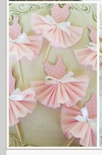 Cupcake picks - a cupcake liner would probably work well for the skirt.