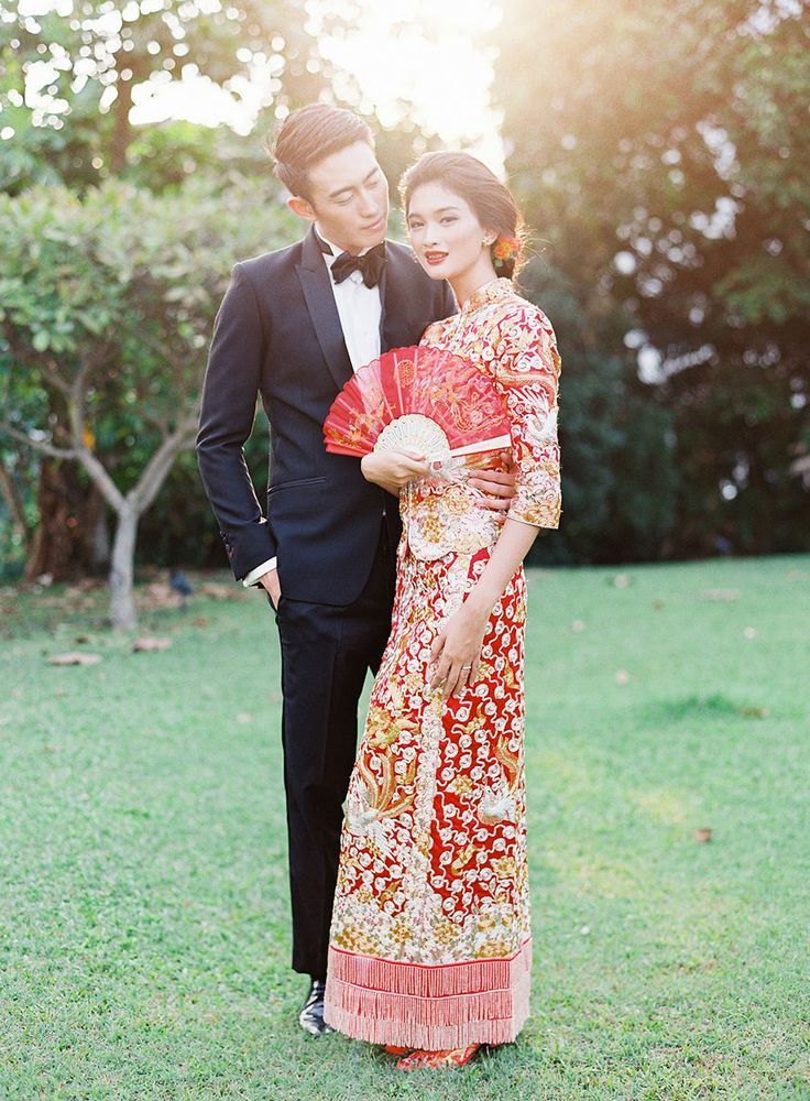 Bride in traditional Qun Kua and groom in a modern tuxedo // Beautiful Traditions: A Styled Shoot at Emily Hill #chinese #weddingdress