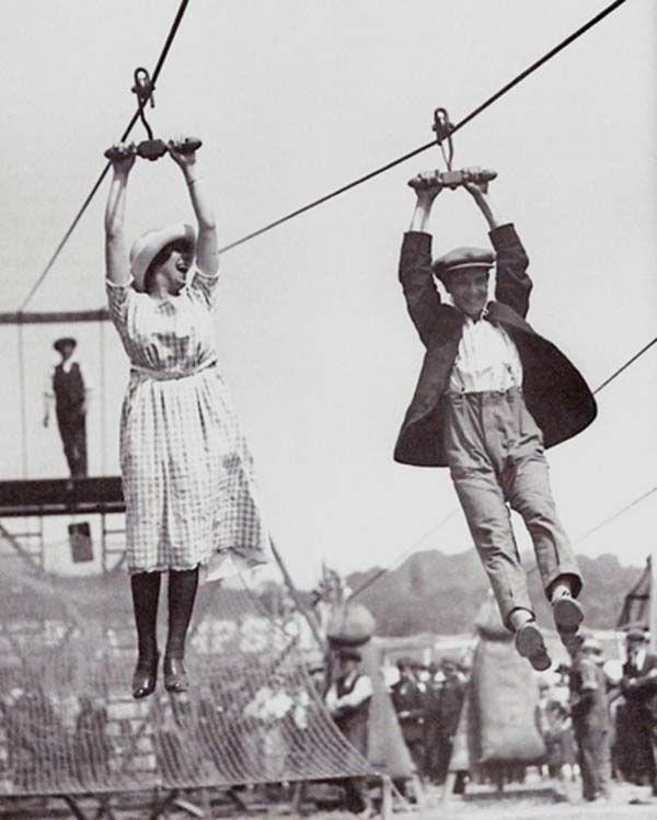 11.) A couple enjoys an old-fashioned zipline at a fair (1923).