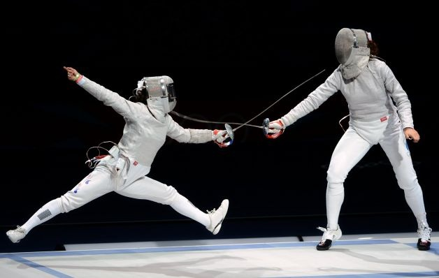 Fencing was included for the first time at the 1896 Games in Athens, and has remained on the Olympic program since then. The women's fencing competition entered the Games in 1924 in Paris. Here, Russia's Sofya Velikaya, right, fences against South Korea's Kim Ji Yeon at the London 2012 Games. (TOSHIFUMI KITAMURA / AFP/Getty Images)