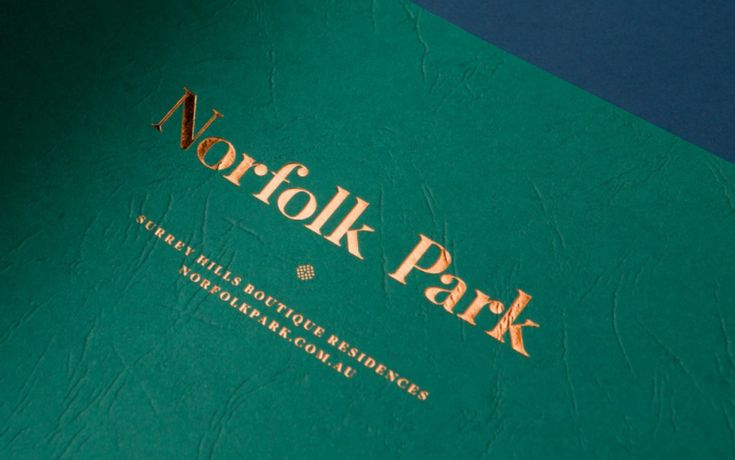 Love this gold embossed logo on emerald green paper