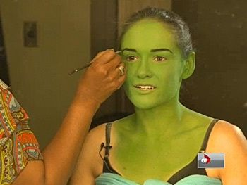 this is how they turn the actress into Elphaba.     http://montreal.broadway.com/buzz/163441/watch-wicked-tour-star-christine-dwyer-turn-green-as-elphaba/