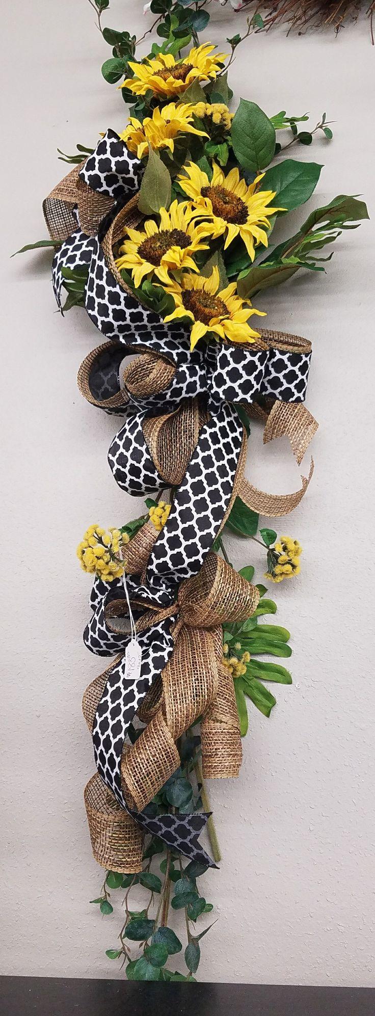 Sunflower swag with black and white ribbon, burlap, split leaf philodendron, designed by Master Designer Nichole Lefebvre at Silks and Crafts in Denham Springs,  LA