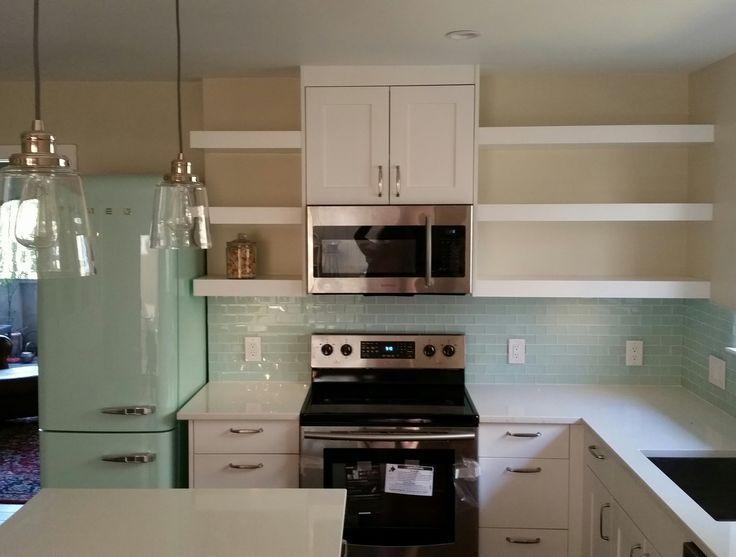 SMEG mint fridge glass tile samsung OTR microwave with vent hood white shaker cabinets glass pendants home depot