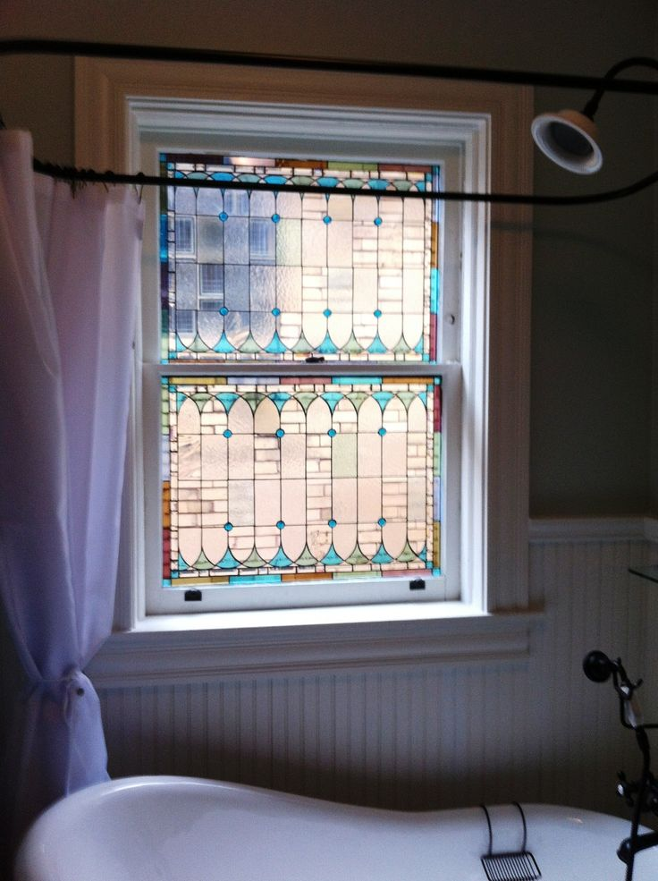 Stained glass window, wainscotting, grey and white, and a claw foot tub = my new…