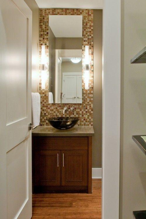 Powder room: vessel sink, narrow mirror, tiled wall behind mirror