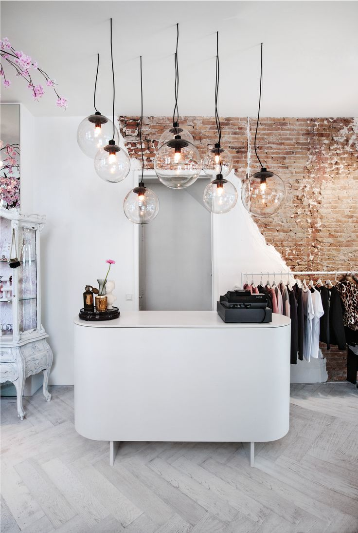 fashion boutique - design by judithvanmourik | interior architecture #bricks #lighting #bulbs #whites #herringbone #eclectic #style