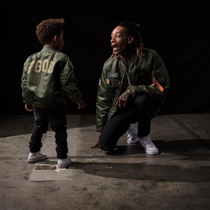 Wiz Khalifa and his son, Sebastian Taylor Thomaz love their bombers from the Alpha x Junk Food collab BASH.