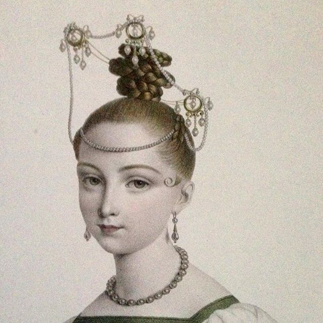 """Love the fanciful hairdos & glittering hair accessories of the late Georgian period! This lithograph titled """"Coeffure Francaise, d'une jeune personne"""" by J. B. Pointel Du Portail, 1831 - most certainly captures the style of that era! Professionally coiffed by the Paris master of hair, Guillaume, the young lady wears an extravagant hair jewel of three pearl pendants with multiple drops, on ropes of pearls framing her tightly braided updo. Perfection!❤️ From the book 25,000 Years of Jewellery....:"""