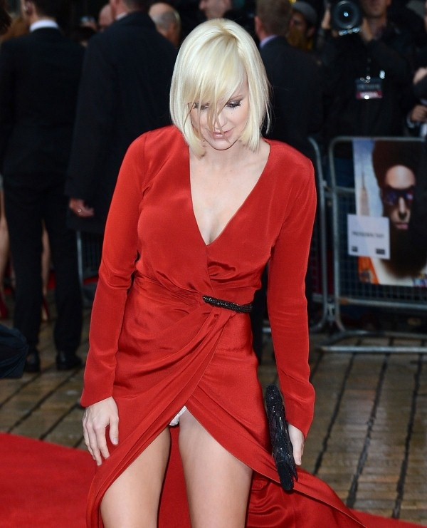 Here are 12 pics of ANNA FARIS at World Premiere of The Dictator in London. The hot actress is wearing a red wrap dress.