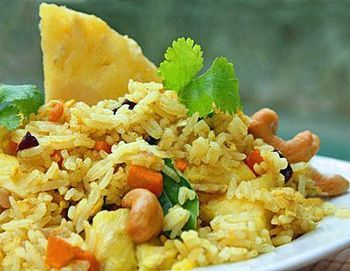 This classic Thai pineapple fried rice recipe is real vegetarian Thai food. Make this easy fried rice at home--it's as good or better than take-out fried rice!