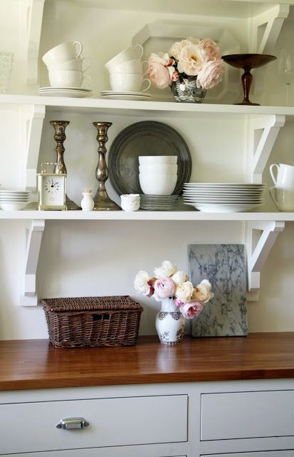 Brackets. Simply White by Benjamin Moore on walls and cabinets. Flat on walls and semi-gloss on cabinets.