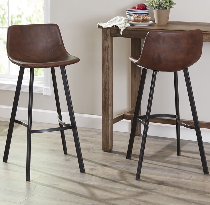 The Mary-Kate Bar Stool is a great addition to your home. Featuring a padded seat cushion and a convenient foot rail, these bar stools will allow you sit comfortably. With it's concave seat and back rests, you will feel as though it was made just for you. The unique curved steel legs brings out the uniqueness of these stools. Upholstered with polyurethane leather, these bar stools are easy to clean for all of life's spills.