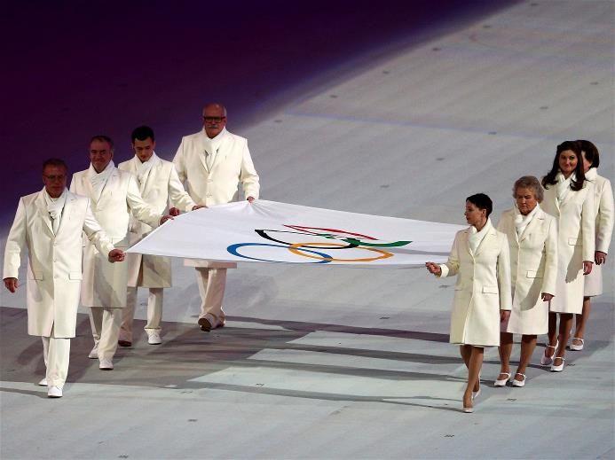Olympic flag bearers Chulpan Khamatova, Lidiya Skoblikova, Anastasia Popova, Valentina Tereshkova, Vyacheslav Fetisov, Valeriy Gergiev, Alan Enileev and Nikita Mikhalkov carry the Olympic flag during the Opening Ceremony.