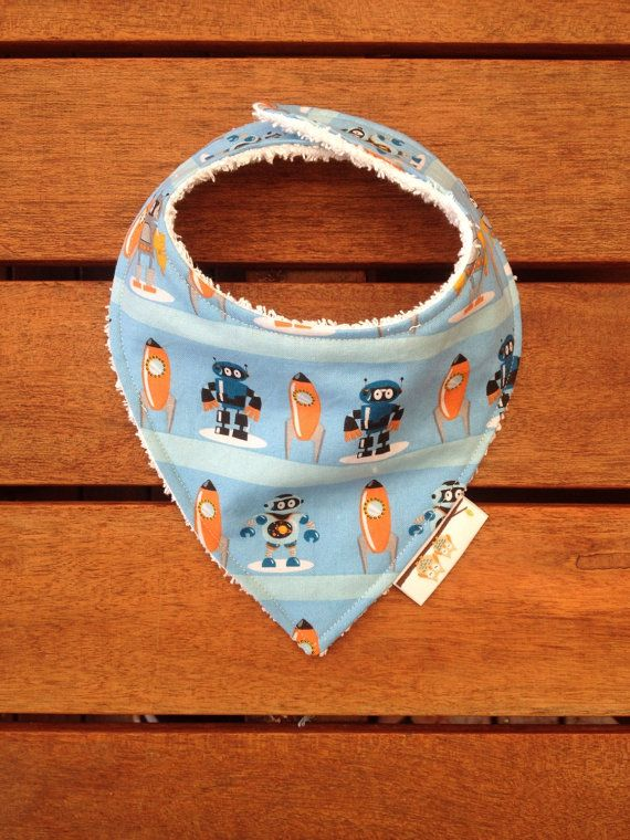 Check out this item in my Etsy shop https://www.etsy.com/listing/183726094/baby-dribble-bib-robot