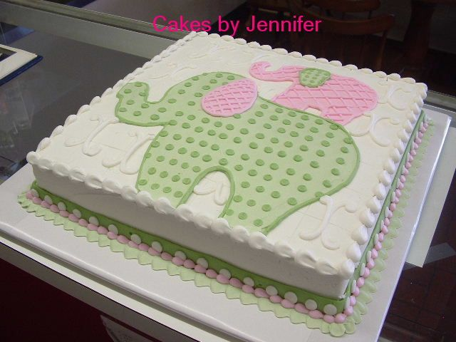 A vanilla sheet cake with grey and navy elephants would be nice. I dont like fondant.   Baby Elephants