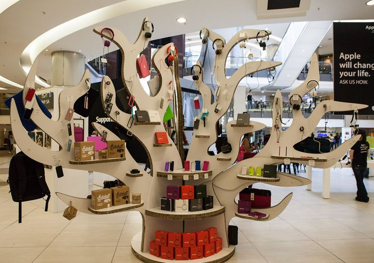 RSW created this tree-shaped display shelf for Sandton's iStore.