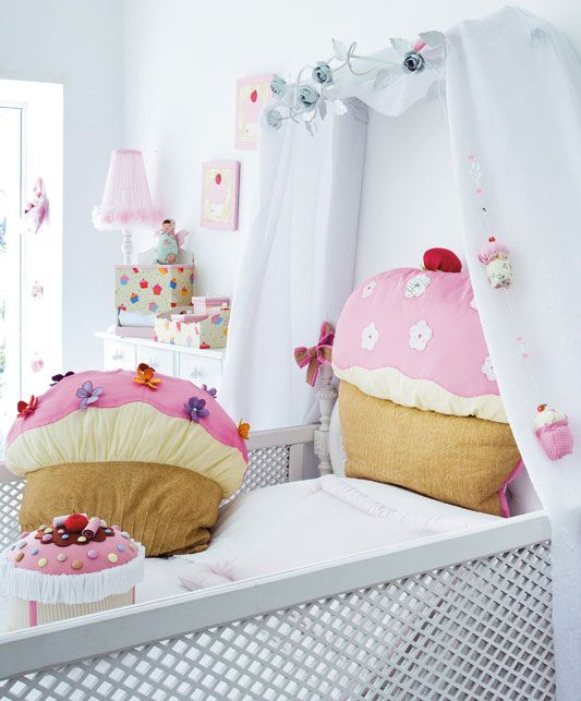 This is the BEST thing Ive seen all day. I NEED that giant cupcake pillow.... hint hint