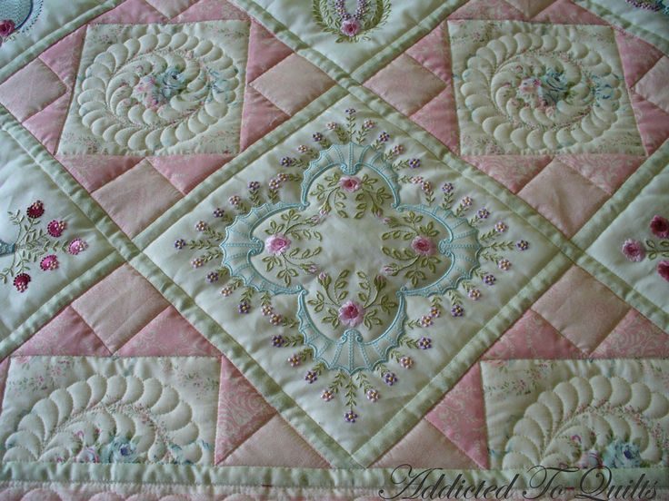 Two more quilts made from Janet Sansom's  embroidery designs.  I think both of these are very pretty.  Quilted with outlining on the embroid...