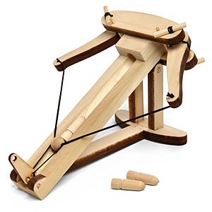 Wooden Ballista Kit    Ancient siege weapon - you know, for fun!  Build your own desktop ballista that really fires!  Laser cut wood builds a ballista based on an an Ancient Roman design.  Fires about 30 feet!