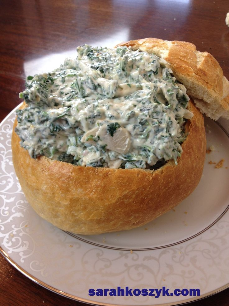 Low-Fat Spinach Dip with Greek Yogurt in a Bread Bowl. Fantastic for Parties!  Recipe: http://www.sarahkoszyk.com/wordpress/?p=44