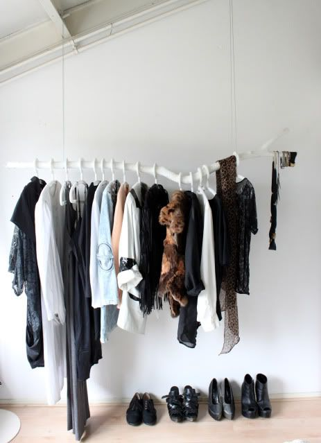 branch used as a clothing rack.