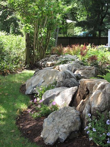 Front yard retaining wall with plantings around it....Moss Rock Retaining Wall. For circle drive at the farm!