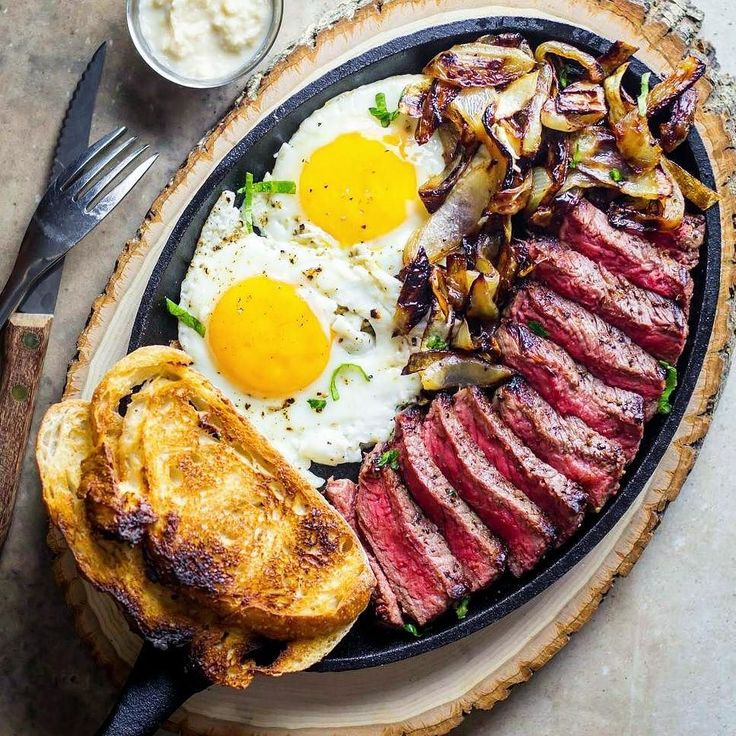 Farm to table. Perfectly grilled steak and eggs with caramelized onion and garlic roasted artisan sourdough bread butter and fresh herbs. Simplicity. Perfection. Rise shine & be great! #myfoodeatsyourfood  . Courtesy: Fork In Pancakes | @forkinpancakes . . . . . Blog: http://ift.tt/1vCV6pv  #chef #grill #grilling #bbq #barbecue #breakfast #brunch #eggs #coffee #beef #carne #churrasco #sunrise #meat #carnivore #paleo #glutenfree #instagood #foodstagram #foodgasm #foodpics #foodporn #steak…