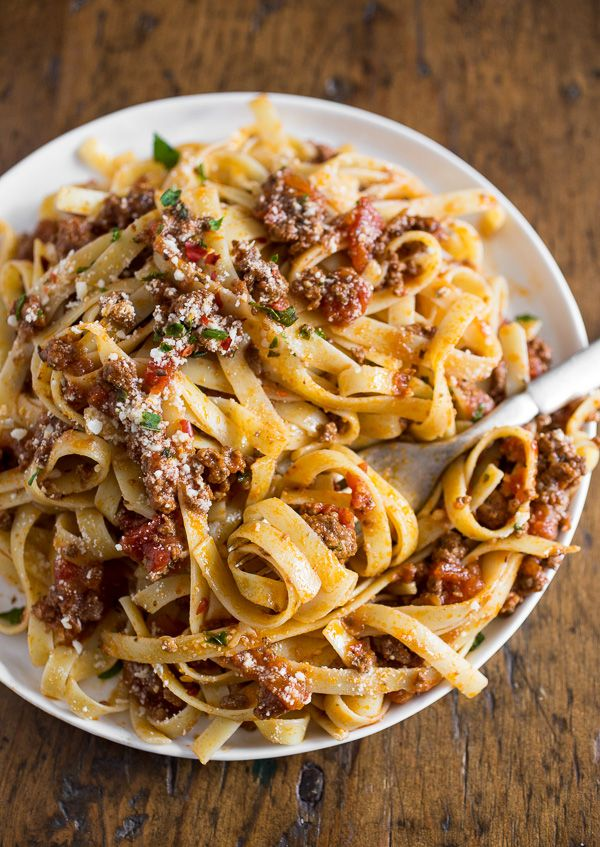 This slow cooker Parmesan meat sauce is slow cooked and full of flavor. Perfectly seasoned and goes great over fresh pasta. Plus it can be easily frozen!