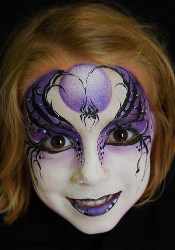 Love this painted face. The purple goes perfectly with her hair too.