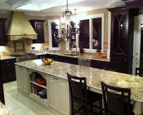 marble/granite counter, dark cabinets, multicoloured brick, country style hob - combination looks very dated