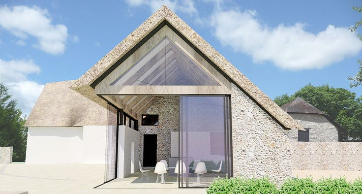 Contemporary thatched roof extension to listed farmhouse with structural glass sliding doors, green oak frame, and flint stone walls