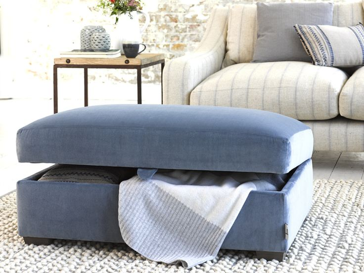 Bumper is a storage blanket box and a footstool. Handmade in Britain, upholstered here in Winter Sky clever velvet and available in over 120 gorgeous fabric. Comes with solid beech weathered legs.