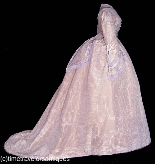 A very romantic original circa 1867 lady's lilac colored fully trained silk taffeta three piece gown : side view