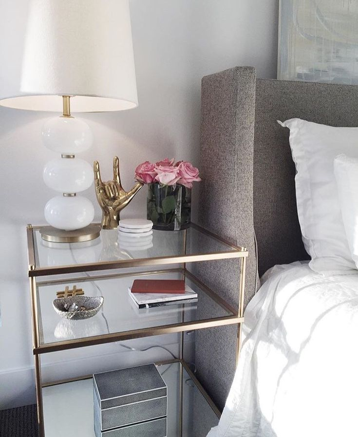 Side table | clear Glass with brass accents. Chic and feminine