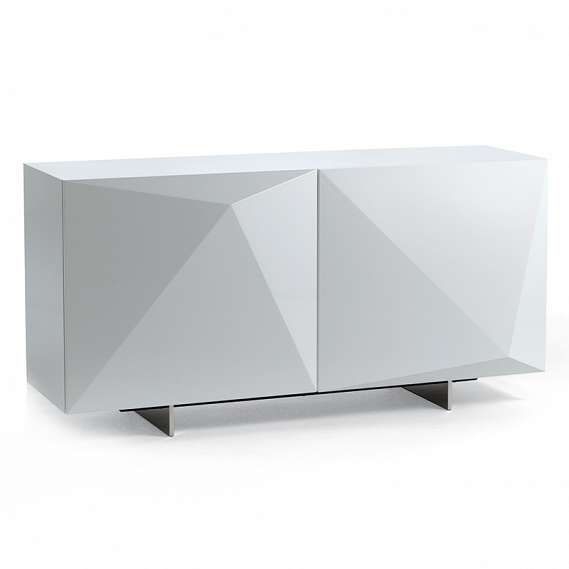 The Kayak sideboard by Cattelan Italia elevates dining storage to another level of modern sophistication. The three-dimensional doors make this unique piece a sight to behold. The contemporary sideboard is avaiable in a variety of subtle and bright colors including glossy black (L3), glossy white (L7), glossy moka (L4), glossy red (L8 or matt graphite (OP69). For the perfect pairing please consider the Diamond mirror to continue faceted theme.