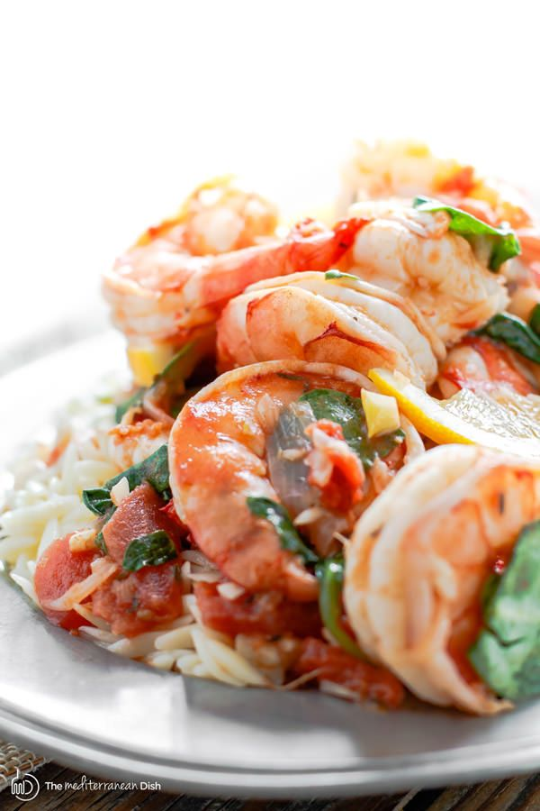 Garlic-Shrimp Orzo Recipe   The Mediterranean Dish. This easy Mediterranean shrimp recipe is the perfect weeknight meal. A few ingredients like white wine, lemon juice, garlic and tomatoes make a special flavor-packed sauce for the prawns or shrimp. Add a simple orzo or pasta of your choice and voila!
