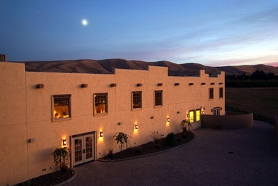 Desert Wind Winery is a Southwest-inspired winery perched on a bluff overlooking the Yakima River. The facility includes a tasting room and gift shop, a private event facility, a restaurant and demonstration kitchen, and four overnight guest rooms.