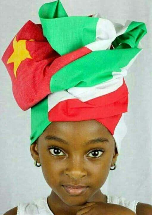 Beautiful Surinam little girl with Surinam flag wrap around...  I love it!