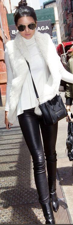 Kendall Jenners aviator sunglasses rayban, leather handbag celine, white vest june snap, and ankle boots celine?